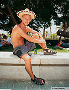 Man sitting on a wall wearing a spanish style hat Ibiza 2001