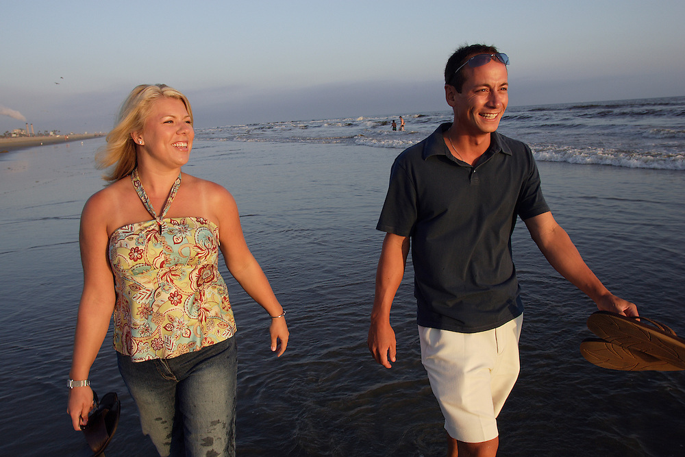 HUNTINGTON BEACH, CA - Aug 10, 2005:  David Ping and his wife, Karen, take time to stroll the beach at Huntington Beach as the sun sets over the Pacific Ocean on August 10, 2005. (Photo by Todd Bigelow/Aurora)