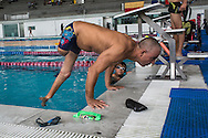 2016/06/03 &ndash; Bogotá, Colombia: Moises Fuentes Garcia, 41, does pushovers on the border of a pool after a training session at the Simon Bolivar Aquatic Complex, Bogotá, 3rd June, 2016.<br />  -<br /> Moises used to be a farmer and sell cattle with his brother when in October 1992, Paramilitaries in the region of Santa Marta targeted them. Moises was shot six times, and his brother killed. He was &ldquo;lucky&rdquo; to survive, one of the bullets crossed his neck, and one stuck into his spine and he couldn&rsquo;t walk again. However it did not end there, a few months later, during a rehabilitation session he broke his leg and due to an infection he had to amputate it. Moises felt it wasn&rsquo;t worth living anymore. But after meeting a group of other victims that had even more severe injures, he grabbed life with will and began to feel motivated. He started playing wheelchair basketball and studying. In the process of the rehabilitation he was spotted as a good swimmer, even if he didn&rsquo;t possess any technique. After some success on the swimming pool, he became completely dedicated to the sport, while finishing degrees as a tailor, public accountant and hopes to graduate as a sport teacher next year. <br /> Among many achievements he won the Bronze medal in 2008 Paralympic Games in Beijing and Silver medal on the 2012 Paralympic Games in London on the 100 meters breaststroke category. He also became the World Champion at the 2013 World Swimming Championships. Moises hopes that in the Rio 2016 Paralympics, he will bring gold home. <br /> He believes that people must value their life, what they have and help people on the way. &ldquo;Everyone is a champion, but some people don&rsquo;t do the necessary to really became one&rdquo; he says. (Eduardo Leal)