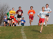 Warwick, N.Y. - Runners head down a hill during a boys' race at the New York State Public High School Athletic Association cross country championships at Sanfordville Elementary School on Nov. 11, 2006.<br />