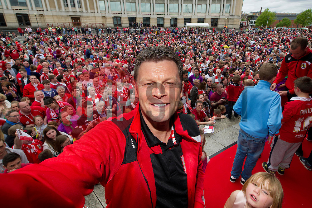 """Bristol City manager, Steve Cotterill takes a """"selfie""""  in front of the thousands of fans gathered at the amphitheatre in Bristol  - Photo mandatory by-line: Joe Meredith/JMP - Mobile: 07966 386802 - 04/05/2015 - SPORT - Football - Bristol -  - Bristol City Celebration Tour"""