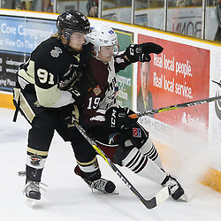TRENTON, ON  - MAY 4,  2017: Canadian Junior Hockey League, Central Canadian Jr. &quot;A&quot; Championship. The Dudley Hewitt Cup Game 6 between Trenton Golden Hawks and the Dryden GM Ice Dogs.   Mac Lewis #91 of the Trenton Golden Hawks hits  Colton Sandboe #19 of the Dryden GM Ice Dogs  during the first period<br /> (Photo by Alex D'Addese / OJHL Images)