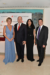 Left to right, AMANDA HOLDEN, H.S.H.PRINCE ALBERT II OF MONACO,  RENU MEHTA and MARK KENBER at the Fortune Forum Club dinner in the presence of HSH Prince Albert II of Monaco held at The Dorchester, Park Lane, London on 15th January 2014.