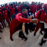 Bradley Chubb of the North Carolina State Wolfpack dances with one of the Sun Bowl Sun Princesses at  arrival in El Paso Texas for the 84th Annual Hyundai Sun Bowl. December 25, 2017