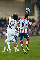 Atletico de Madrid's Raul Garcia and Real Madrid's Marcelo during 2014-15 Spanish King Cup match at Vicente Calderon stadium in Madrid, Spain. January 07, 2015. (ALTERPHOTOS/Luis Fernandez)