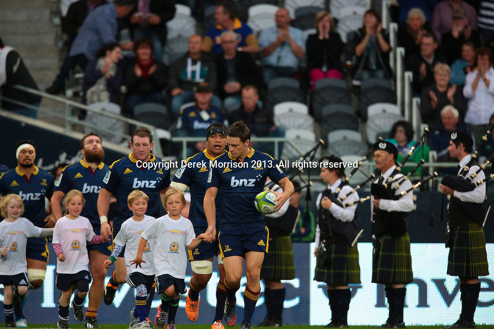 Ben Smith leads the Highlanders out on to the fiels for the Round 5 Super Rugby match between Otago Highlanders and Western Force at Forsyth Barr Stadium, Dunedin. 15 March 2014. Photo: Derek Morrison/www.photosport.co.nz