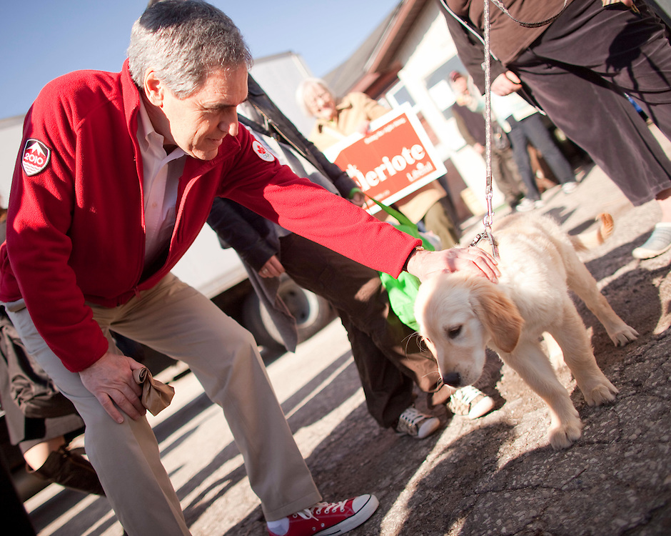 Liberal leader Michael Ignatieff pets a puppy during a campaign stop at a farmers market in Guelph, Ontario April 30, 2011.<br /> REUTERS/Geoff Robins