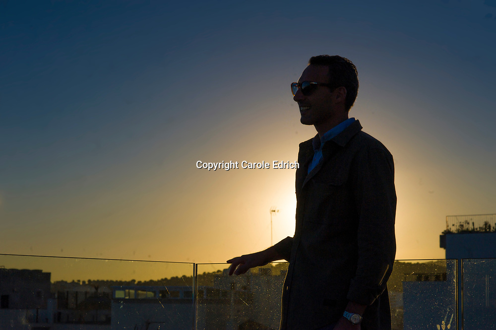 Profile, portrait backlit by setting sun on roof of Nakar Hotel. (c) Carole Edrich 2017