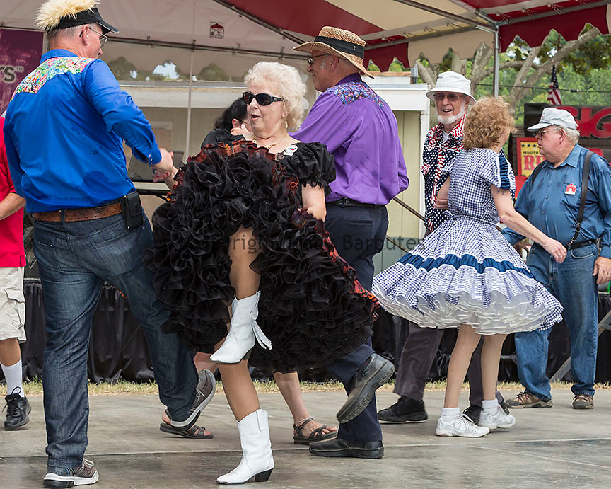 Sunday, July 19, 2015<br /> Audrey Barney kicks up her heels with other members of the Central California Square Dance Association members during the Stanislaus County Fair in Turlock, California, on Sunday, July, 19, 2015.