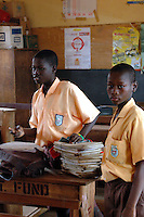 Ghana, Accra, Kokomlemle, 2007. Students come in early to distribute the previous night's corrected homework at Kwameh Nkrumah Memorial School.