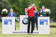 Chris Wood kisses the trophy during the BMW PGA Championship at Wentworth Club, Virginia Water, United Kingdom on 29 May 2016. Photo by Phil Duncan.