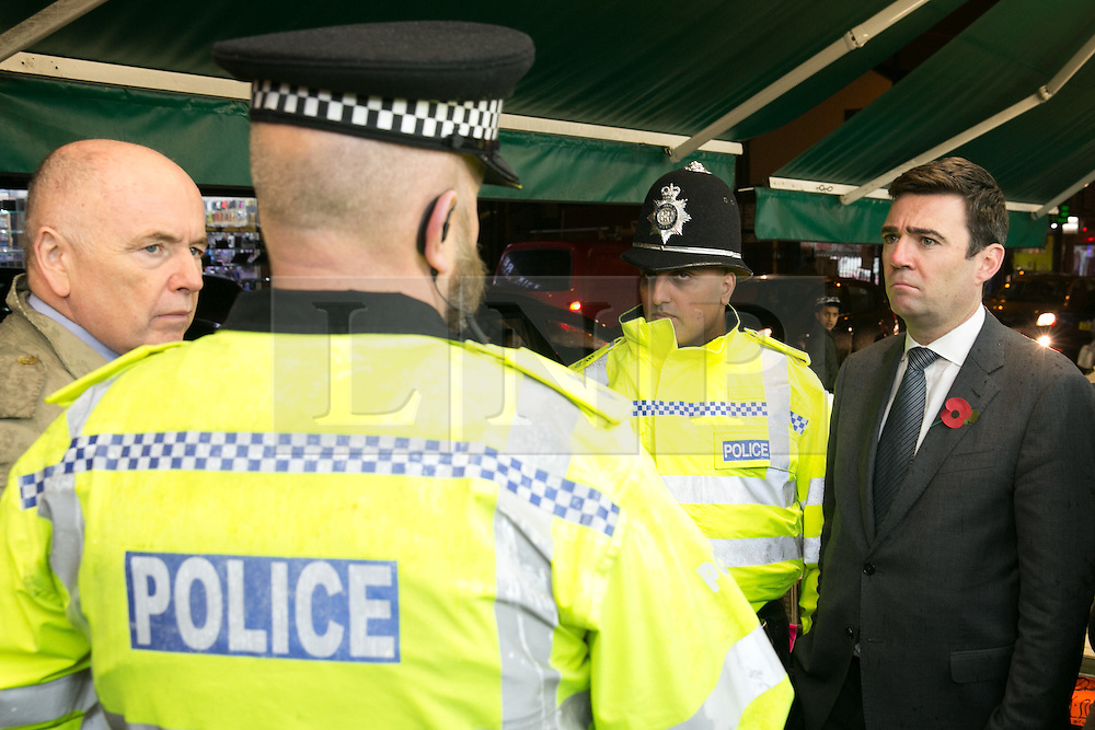 © Licensed to London News Pictures. 03/11/2015. Alum Rock, Birmingham, UK. Shadow Home Secretary ANDY BURNHAM visiting Alum Rock in Birmingham to launch the Labour Policy on Policing. Pictured, from left, JACK DROMEY MP for Erdington, Inspector CHRIS SMITH, Sgt IFTI ALI, ANDY BURNHAM on the Alum Rock Road. Photo credit : Dave Warren/LNP