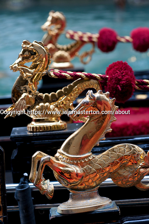 Ornate golden decorations on gondolas in Venice Italy