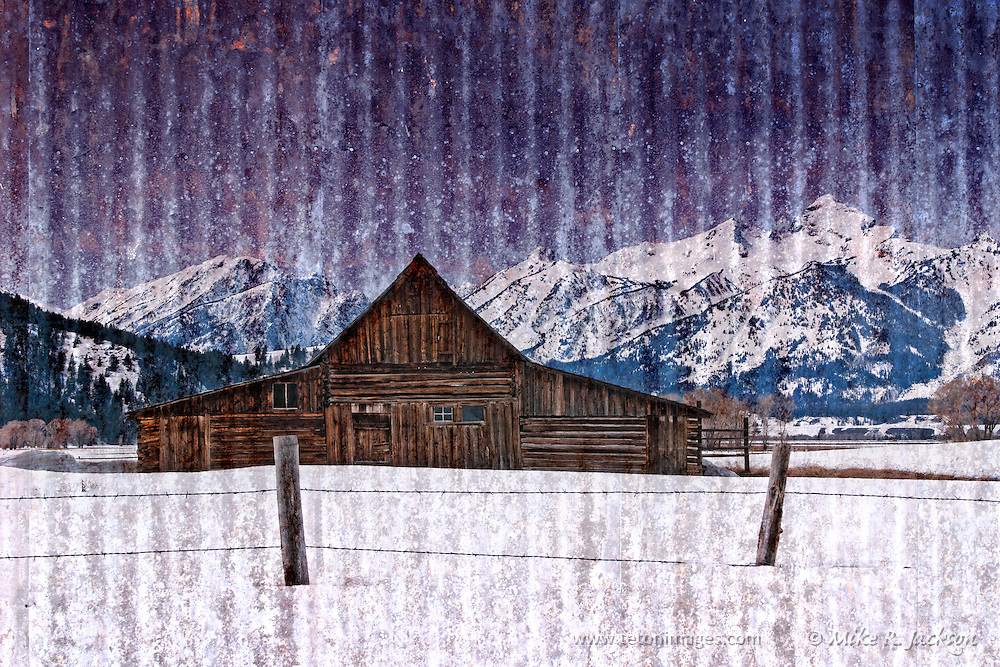 A barn in Grand Teton National Park with distant mountains and close fence. Artistic texture applied.
