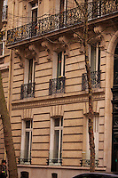 The streets of Paris are home to many intricately designed balconies and balustrades. Paris, France.