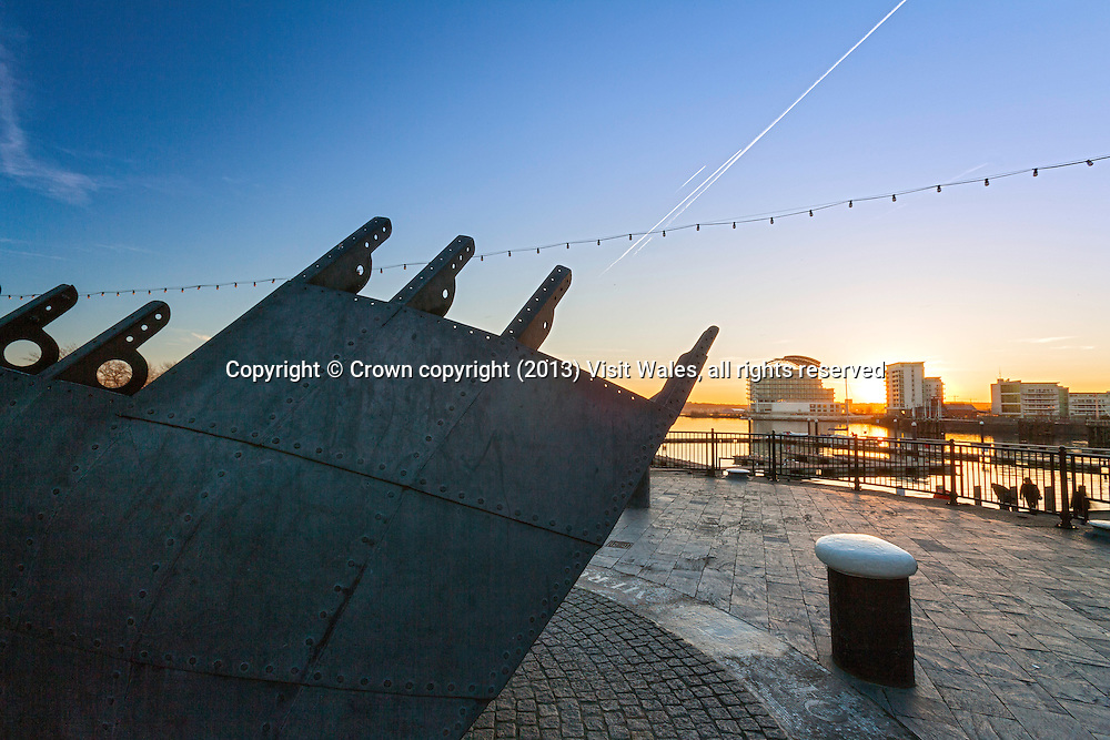 St David's Hotel and Spa at sunset with lifeboat memorial in foreground<br /> Cardiff Bay<br /> Cardiff<br /> South<br /> Towns and Villages