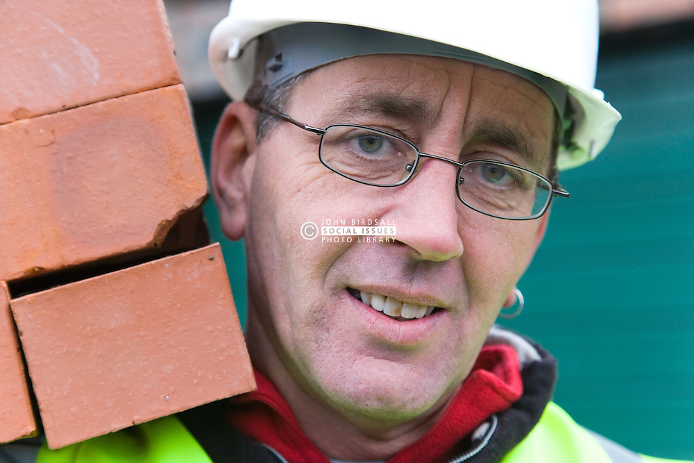 Builder carrying a hod of bricks,