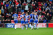 Conor McAleny of Wigan Athletic is congratulated after making it 1-0 to Wigan during the Sky Bet League 1 match between Walsall and Wigan Athletic at the Banks's Stadium, Walsall, England on 20 February 2016. Photo by Mike Sheridan.