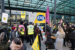 London, UK. 22nd January, 2019. Support staff at the Department for Business, Energy and Industrial Strategy (BEIS) represented by the Public and Commercial Services (PCS) union stand on the picket line after beginning a strike for the London Living Wage of £10.55 per hour and parity of sick pay and annual leave allowance with civil servants. The strike is being coordinated with receptionists, security staff and cleaners at the Ministry of Justice (MoJ) represented by the United Voices of the World (UVW) trade union.