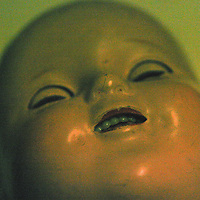 Conceptual image of dolls face
