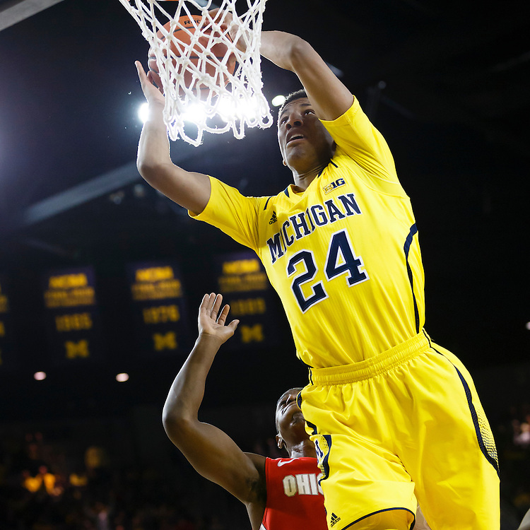 Feb 22, 2015; Ann Arbor, MI, USA; Michigan Wolverines guard/forward Aubrey Dawkins (24) attempts to dunk  in the first half against the Ohio State Buckeyes at Crisler Center. Mandatory Credit: Rick Osentoski-USA TODAY Sports