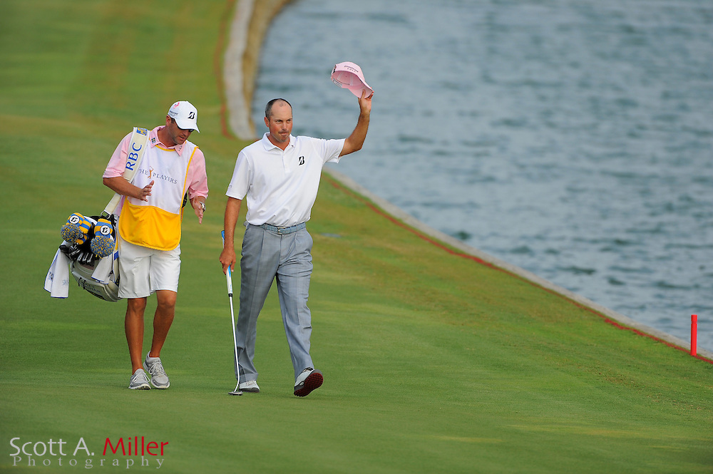 Matt Kuchar and his caddie walk up the 18th fairway during the final round of the Players Championship at the TPC Sawgrass on May 13, 2012 in Ponte Vedra, Fla. ..©2012 Scott A. Miller..