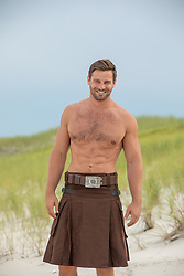 hot man in a kilt outdoors