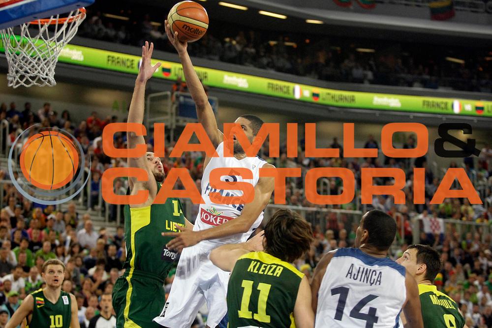 DESCRIZIONE : Lubiana Ljubliana Slovenia Eurobasket Men 2013 Finale Final Francia France Lituania Lithuania<br /> GIOCATORE : Nicolas Batum<br /> CATEGORIA : tiro shot<br /> SQUADRA : Francia France<br /> EVENTO : Eurobasket Men 2013<br /> GARA : Francia France Lituania Lithuania<br /> DATA : 22/09/2013 <br /> SPORT : Pallacanestro <br /> AUTORE : Agenzia Ciamillo-Castoria/A.Cukic<br /> Galleria : Eurobasket Men 2013<br /> Fotonotizia : Lubiana Ljubliana Slovenia Eurobasket Men 2013 Finale Final Francia France Lituania Lithuania<br /> Predefinita :