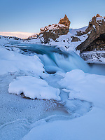 Geitafoss waterfall at sunrise in winter. North Iceland.