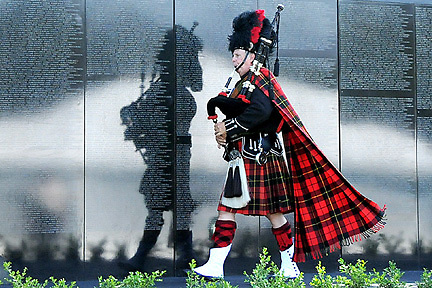 """H:\EDITORIAL\Photos\09 September 2009\JH 9-10-09 Bagpiper Bill Boetticher, a Camarillo resident, performs as he ceremoniously """"clears the wall"""" during the opening ceremony of the Dignity Memorial Vietnam Wall Experience on Friday, September 4, in Westlake Village."""