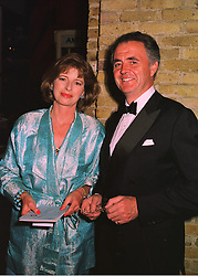 MR & MRS PETER HAMBRO members of the banking family, at a fashion show in London on 12th May 1998.MHL 18