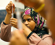 Rukia Aden, 18, of Fargo, N.D., extracts her DNA from a test tube during a TEDxFargo learning event held at the Inspire Innovation Lab in the Moorhead Center Mall on Friday, July 25, 2014, in Moorhead, Minn.<br /> Nick Wagner / The Forum