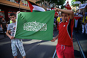 Mainz | 18 July 2014<br /> <br /> Am Samstag (18.07.2014) nahmen etwa 1000 M&auml;nner, Frauen und Kinder in der Innenstadt von Mainz anl&auml;sslich der milit&auml;rischen Auseinandersetzung zwischen Israel und der Hamas in Gaza an einer Solidarit&auml;tsdemonstration f&uuml;r Gaza, ein freies Pal&auml;stina und gegen Israel teil. Bei der Demo wurden Fahnen der Hamas und der Hisbollah mitgef&uuml;hrt, neben den &uuml;blichen Parolen gegen Israel wurde in Sprechch&ouml;hren auch vereinzelt zur Vernichtung von J&uuml;dinnen und Juden aufgerufen.<br /> Hier: Zwei Jungen mit einer Fahne der Hamas.<br /> <br /> <br /> &copy;peter-juelich.com<br /> <br /> [No Model Release | No Property Release]