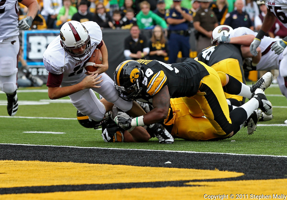 September 24, 2011: Louisiana Monroe Warhawks quarterback Kolton Browning (15) runs 4 yards for a touchdown during the third quarter of the game between the Iowa Hawkeyes and the Louisiana Monroe Warhawks at Kinnick Stadium in Iowa City, Iowa on Saturday, September 24, 2011. Iowa defeated Louisiana Monroe 45-17.