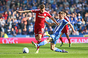 Brighton striker, Solomon March tackles Cardiff City midfielder Anthony Pilkington during the Sky Bet Championship match between Brighton and Hove Albion and Cardiff City at the American Express Community Stadium, Brighton and Hove, England on 3 October 2015. Photo by Phil Duncan.