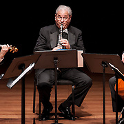 March 30, 2012 - New York, NY : Clarinetist David Shifrin, center, and the Orion String, including violinist Todd Phillips, left, and cellist Timothy Eddy, right, perform Carl Maria Von Weber's 'Quintet in B-flat major for Clarinet, Two Violins, Viola, and Cello, Op. 34 (1811-12, 1815)'  in the Chamber Music Society's presentation of 'Great Clarinet Quintets,'  in Alice Tully Hall at Lincoln Center on Friday evening. CREDIT : Karsten Moran
