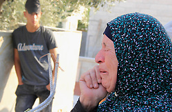 October 26, 2016 - Jerusalem, Jerusalem, Palestinian Territory - A Palestinian woman reacts following Israeli forces demolished her family house which Israeli authorities said it was built without a permit in Wadi Qaddum in the East Jerusalem neighborhood of Silwan on Oct. 26, 2016. A multi-unit building belonging to Jaafreh family was demolished leaving an extended family of 30 Palestinians -mostly children- homeless, after the Jerusalem municipality rejected the family's attempts to obtain building permits for nine year  (Credit Image: © Mahfouz Abu Turk/APA Images via ZUMA Wire)