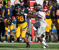 October 24, 2009; Berkeley, CA, USA;  California Golden Bears running back Covaughn DeBoskie-Johnson (28) delivers a stiff arm to Washington State Cougars safety Chima Nwachukwu (21) during the fourth quarter at Memorial Stadium.  California won 49-17.