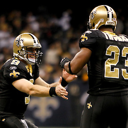 November 28, 2011; New Orleans, LA, USA; New Orleans Saints quarterback Drew Brees (9) and running back Pierre Thomas (23) celebrate following a touchdown  during the fourth quarter of a game at the Mercedes-Benz Superdome. The Saints defeated the Giants 49-24. Mandatory Credit: Derick E. Hingle-US PRESSWIRE