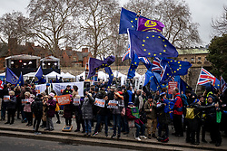 © Licensed to London News Pictures. 15/01/2019. London, UK. Pro-Brexit and anti-Brexit demonstrators protest alongside each other next to television and radio studios set up on College Green, Westminster. This evening, MPs are due to vote on British Prime Minister Theresa May's EU withdrawal deal, after the previous vote in December was postponed. Photo credit : Tom Nicholson/LNP
