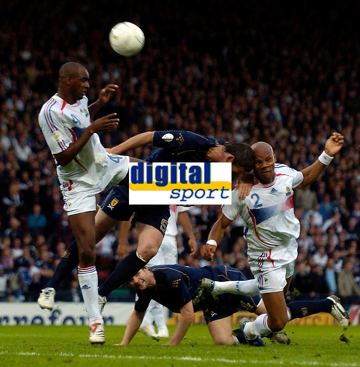Photo: Jed Wee.<br />Scotland v France. UEFA European Championships 2008 Qualifying. 07/10/2006.<br /><br />France's Patrick Vieira (L) and Jean Alain Boumsong cause chaos in the Scottish penalty area.