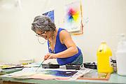 Painting teacher Irene Hentschke demonstrates using a paint brush during Milpitas High School's Back to School Night at Milpitas High School in Milpitas, California, on September 1, 2015. (Stan Olszewski/SOSKIphoto)