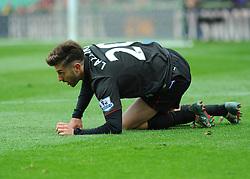 Liverpool's Adam Lallana is brought to the ground - Photo mandatory by-line: Nizaam Jones/JMP - Mobile: 07966 386802 - 24/05/2015 - SPORT - Football - Stoke - Britannia Stadium - Stoke City v Liverpool - Barclays Premier League