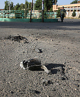 The remains of a Taliban-fired rocket lies on a road where it exploded, killing a 15-year-old boy on his way to a polling station in Lashkar Gah on the day of the Afghanistan presidential elections.