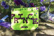 Lime green poster with Prince's name spelled with large purple plastic flowers. Paisley Park Studios Chanhassen Minnesota MN USA