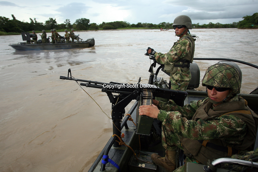 Colombian forces patrol the Arauca River, which borders Colombia and Venezuela, just outside of the Colombian city of Arauca on June 26, 2009. The border region between Colombia and Venezuela has often been a region with a high level of activity of illegal armed groups. (Photo/Scott Dalton)