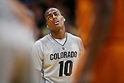 SHOT 2/26/11 5:03:26 PM - Colorado's Alec Burks (#10) during a break in the action against Texas during their regular season Big 12 basketball game at the Coors Events Center in Boulder, Co. Colorado upset the fifth ranked Texas 91-89. Burks scored 33 points in the win. (Photo by Marc Piscotty / © 2011)