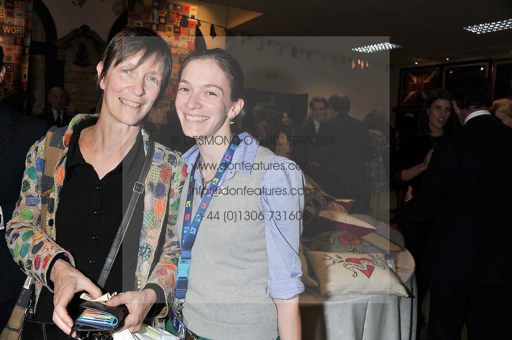 Left to right, PANDORA MAXWELL and her daughter TILLY MAXWELL at a reception to view and buy cushions, quilts, bags and gifts Hand-stitched in British prisons held at The Riffles Club, 56 Davies Street, London W1 on 26th April 2012.