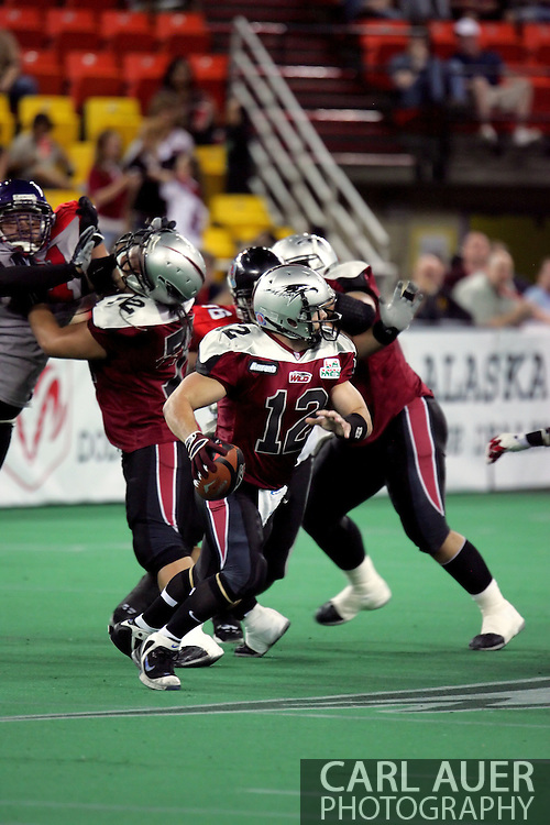 6-28-2007: Anchorage, AK - Quarterback for the Wild, David Short (12) drops back for a pass in the Alaska Wild 47 to 53 loss to the CenTex Barracudas at the Sullivan Arena...