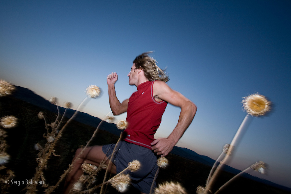 A man trail-running at dusk in the Front Range of Colorado